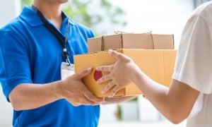 Parcel courier delivering a package