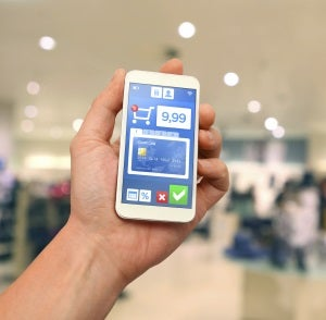 Mobile-payment-with-smartphone-at-retail-store-000050830306_Large