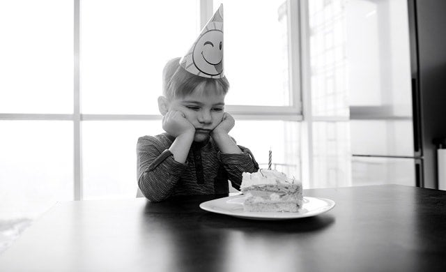 Boy with birthday cake
