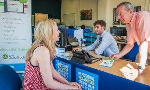 TaxAssist franchisee Nigel Lomax serves customer at his TaxAssist office on Sundorne Avenue, Shrewsbury