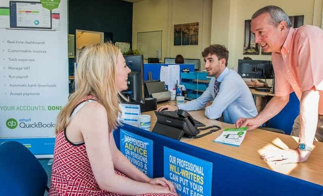 TaxAssist franchisee Nigel Lomax serves customer at his TaxAssist office on Sundorne Avenue, Shrewsbury