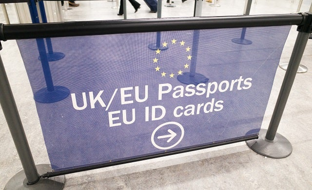 Passport control signage at Gatwick Airport