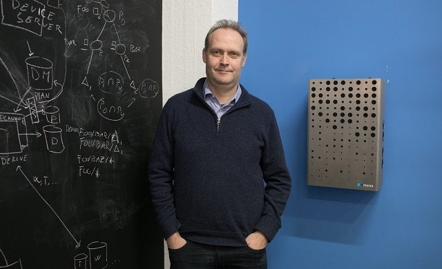 Simon Daniel, CEO and co-founder of Moixa, next to a Moixa smart battery