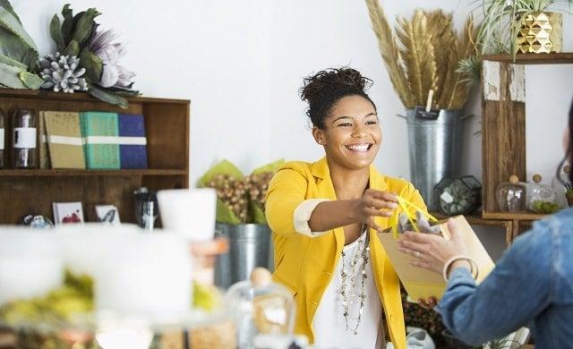 Shop-owner-serving-customer