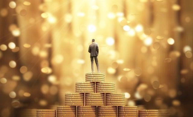 Man-standing-on-money-rich