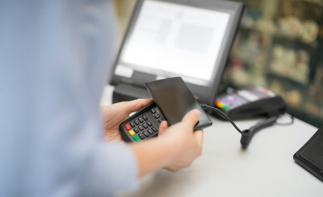POS system taking a mobile payment in a shop