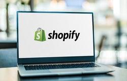 Shopify logo on laptop